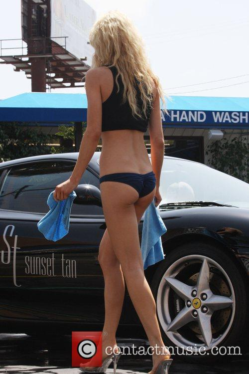 Models on location at a car wash, being...