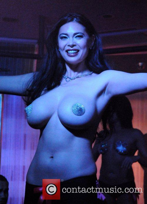 Performs with the world-famous burlesque dancers of Ivan...