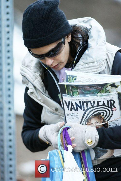 Teri Hatcher picks up mail while walking her...