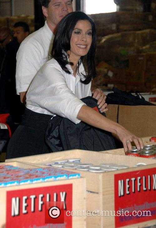 Teri Hatcher Helps Out Filling Backpacks With Food For
