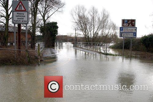 A car park in Tewkesbury completely submerged under...