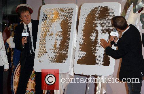 Paul McCartney and George Harrison The Beatles 'Love'...