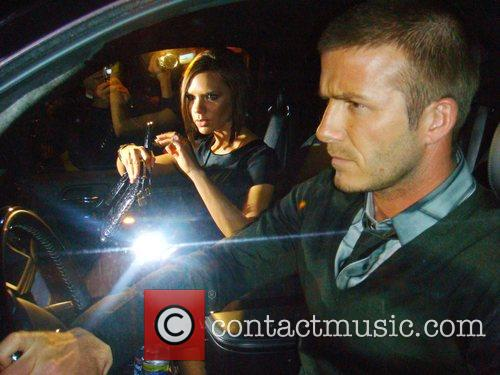 Victoria Beckham and David Beckham drive through Mint...