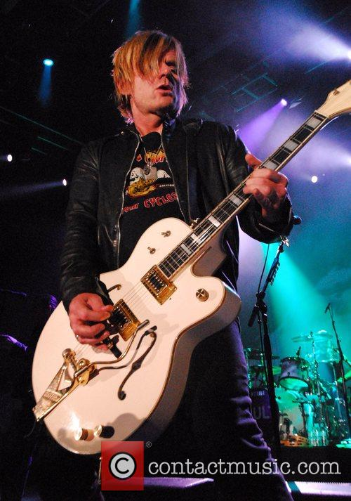 Billy Duffy of The Cult performing live at...