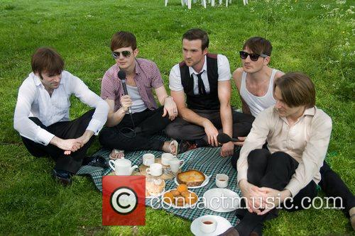 The Feeling sit for a picnic backstage at...