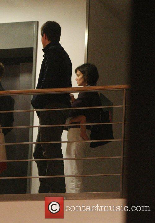 Miles Robbins, Katie Holmes and daughter Suri leaving...