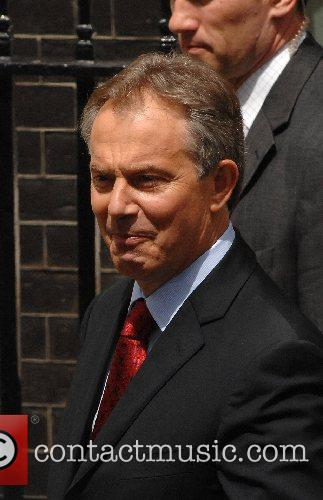 PM Tony Blair heads to Buckingham palace from...
