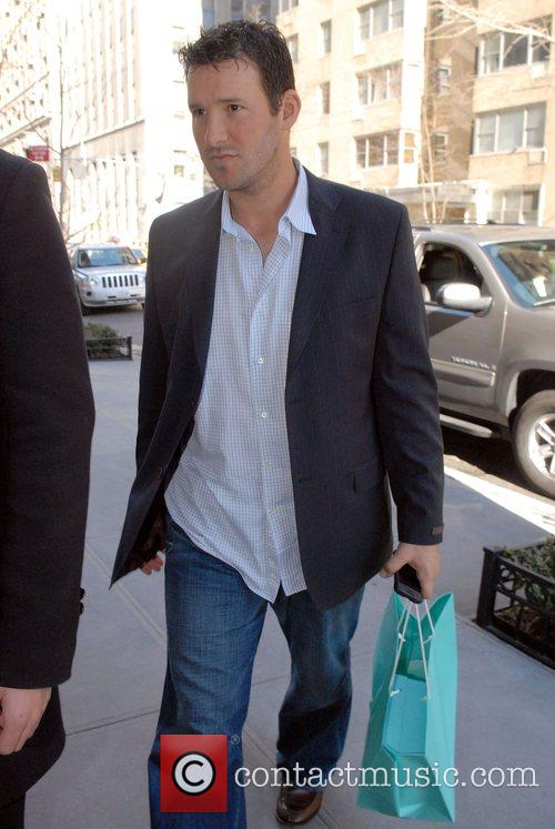 Arriving at his Manhattan hotel carrying a shopping...