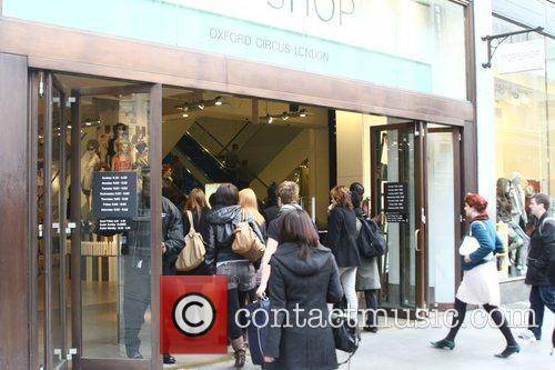 Shoppers flood into Oxford Circus to be the...
