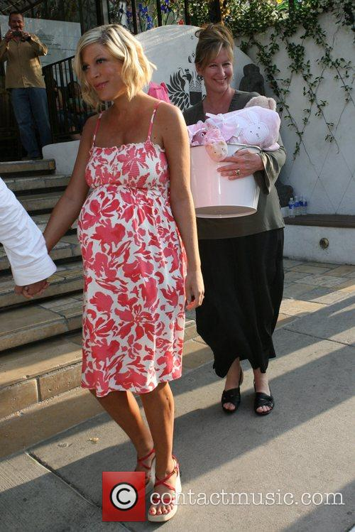 Heavily pregnant, Tori Spelling at a TV show...