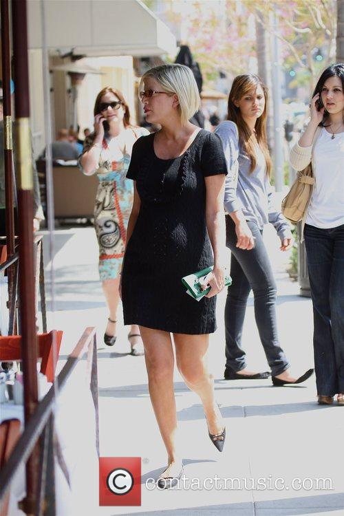 Looks very pregnant as she walks through Beverly...