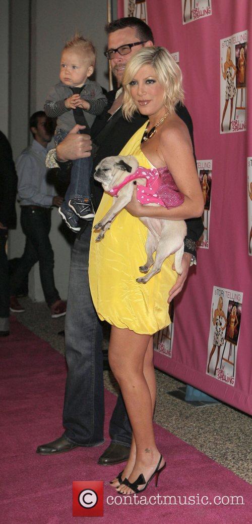Heavily pregnant Tori Spelling her husband Dean McDermott,...