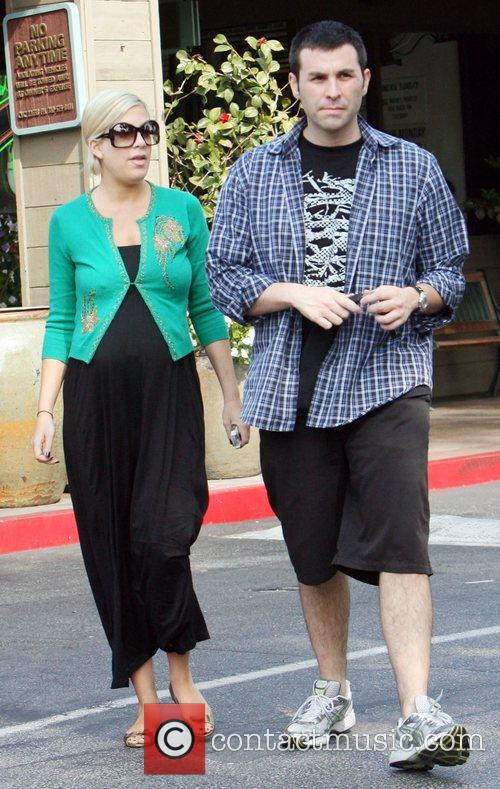 Pregnant actress Tori Spelling shopping with a friend...