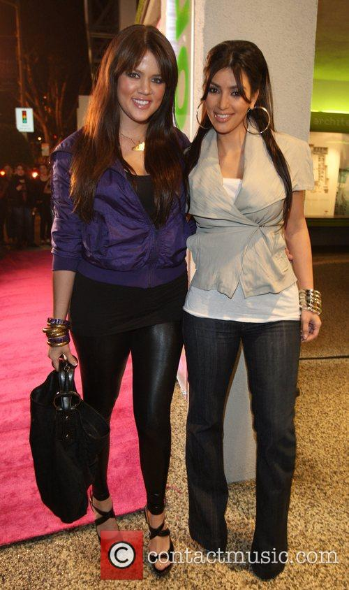 Kim Kardashianand her sister Khloe at the launch...