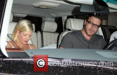Tori Spelling with her husband Dean McDermott promoting...