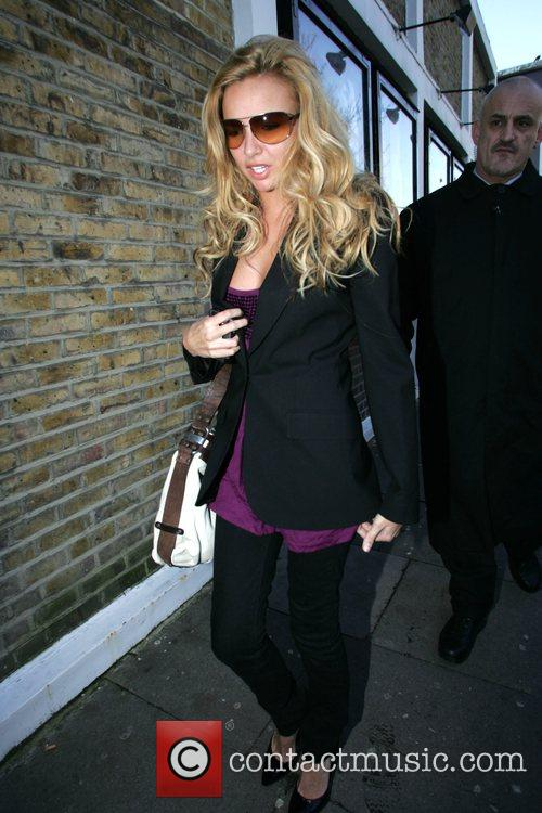 Arrives at a London studio to film a...
