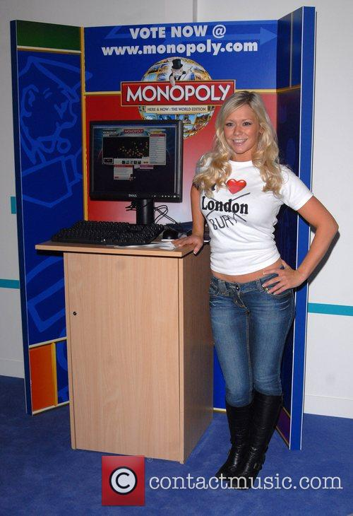Promoting the new Monopoly game at the opening...