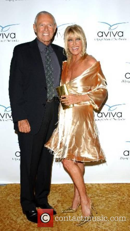 Alan Hamel and Suzanne Summers (wearing a dress...