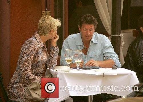 Ty Pennington having an outdoor meal with his...