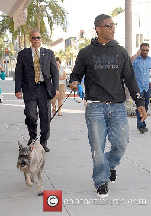 Walking his dog around Beverly Hills