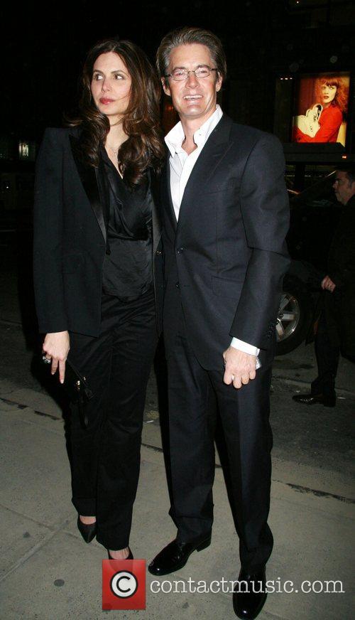 A pregnant Desiree Gruber and Kyle McLaughlin Versace...