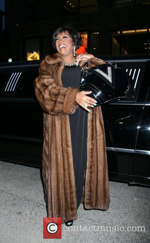 Patti LaBelle shows off her Versace bag Versace...