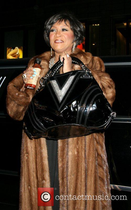 Patti LaBelle shows off her Versace bag and...