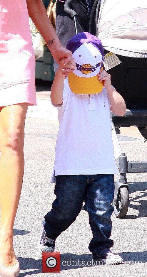 Cruz Beckham hiding his face behind a LA...