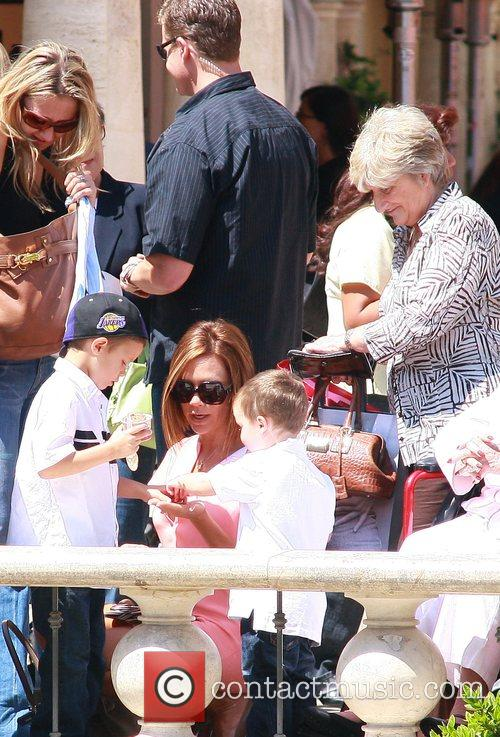 Victoria Beckham takes her youngest sons Romeo Beckham...