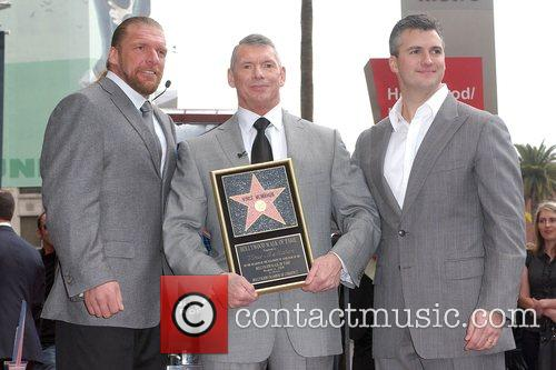 Triple H, Vince McMahon, Shane McMahon Vince McMahon...