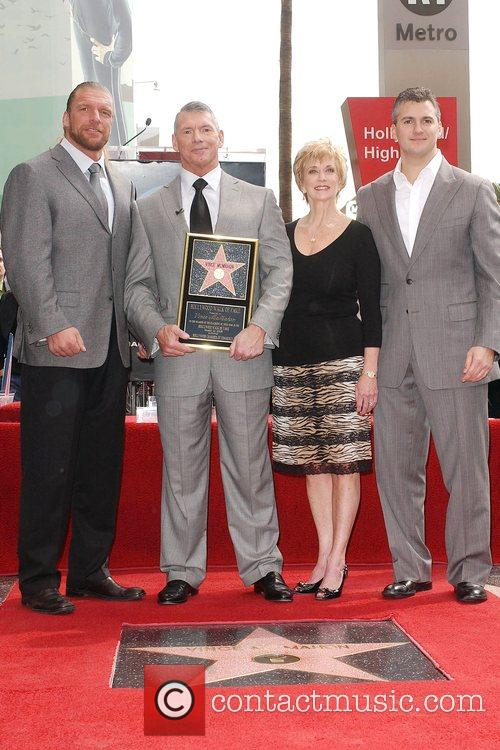 Triple H, Vince McMahon and wife, Shane McMahon...