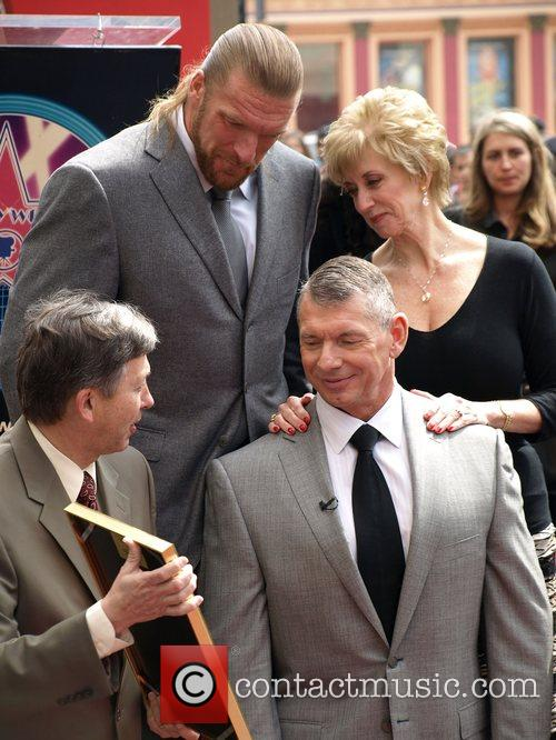Triple H and Shane McMahon, Vince McMahon, Linda...