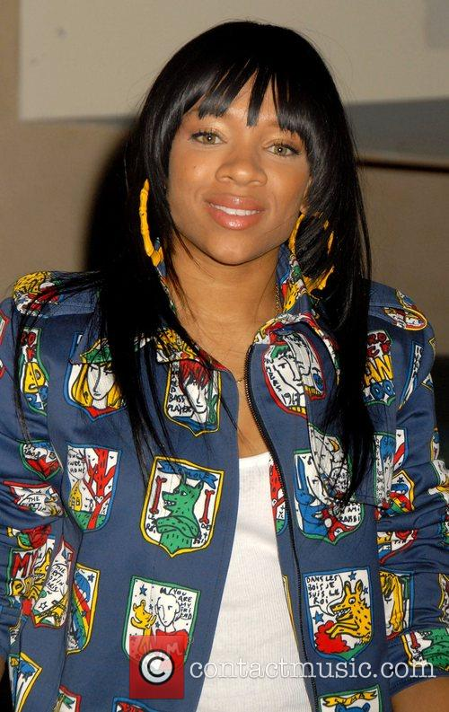 Lil Mama signs copies of her debut album...