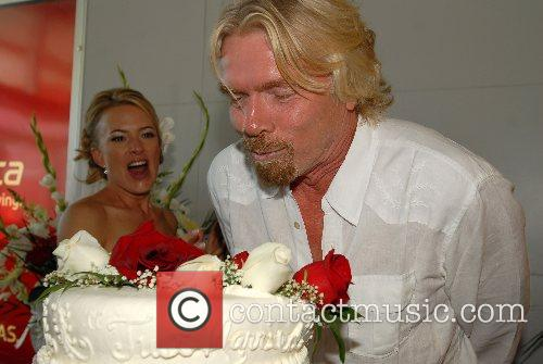 Coco Papdogonas and Richard Branson Virgin America celebrates...