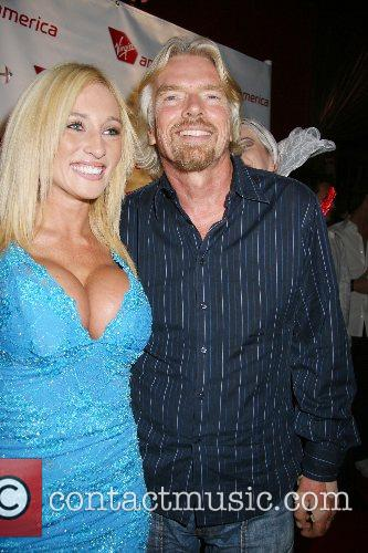 Kyla Ebbert and Sir Richard Branson Virgin America's...