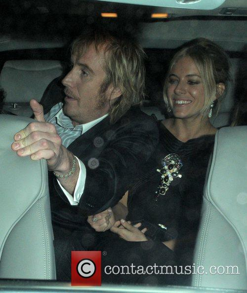 Rhys Ifans and Sienna Miller at the Vogue...