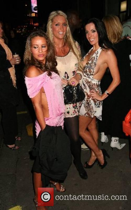 Coralie Robinson and Guest leaving the WAGs Boutique...