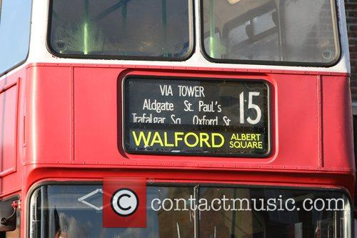 London bus with the destination Walford being driven...