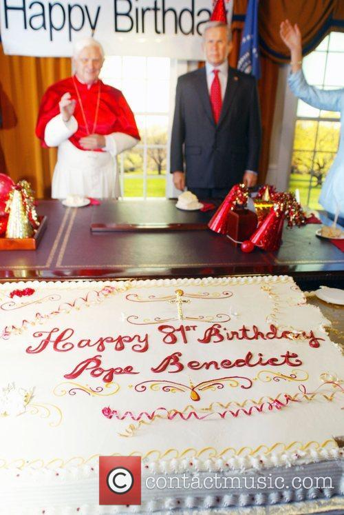 Pope Benedict XVI wax figure and U.S. President...