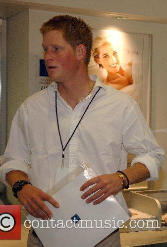 Prince Harry checks out the programmes prior to...