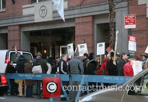 WGA Protestors marching outside the ABC building Manhattan,...