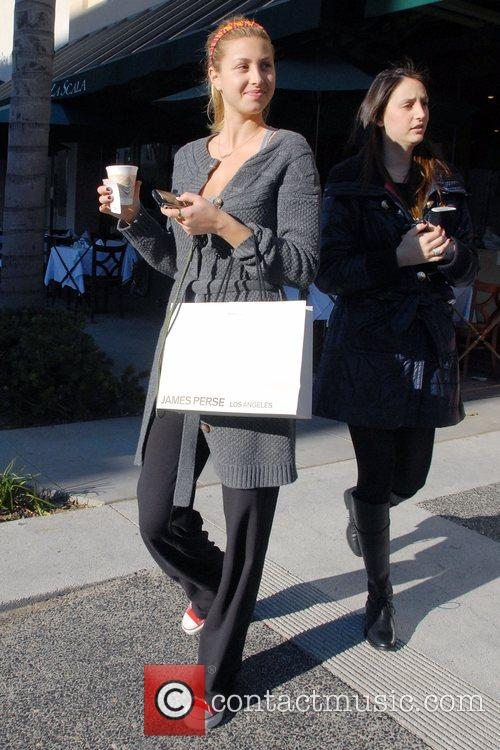 The Hills' Whitney Port drinking coffee and carrying...