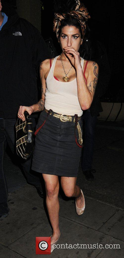 Amy Winehouse leaves after playing at Bloomsbury Bowling...