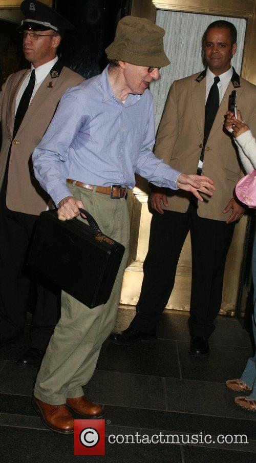 Woody Allen looking sweaty after leaving his hotel...