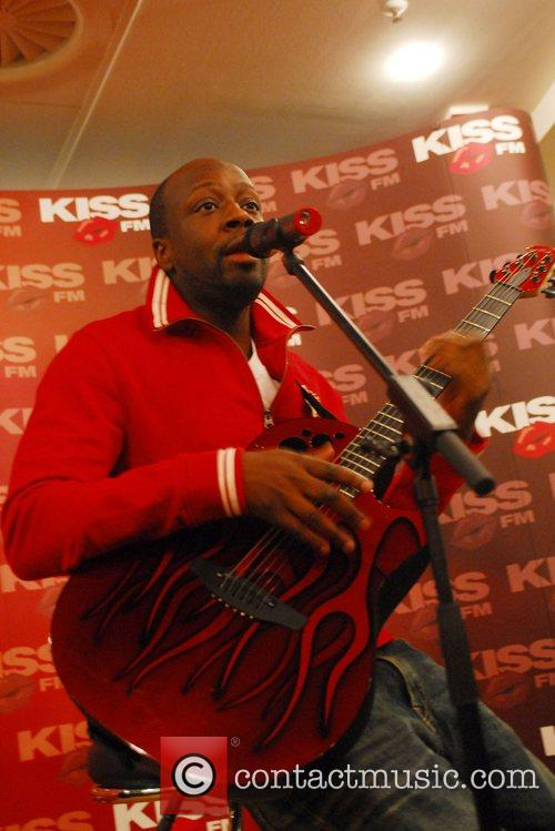 Wyclef Jean performing live at an intimate concert...