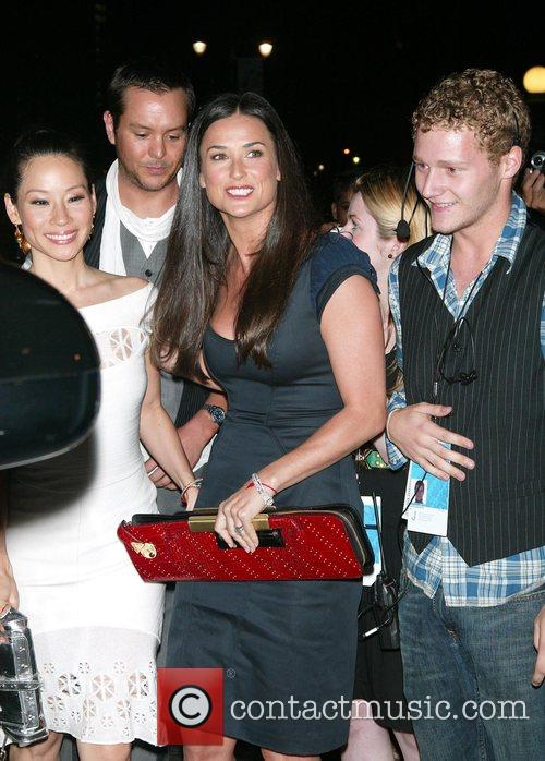 Lucy Liu and Demi Moore (holding her red...