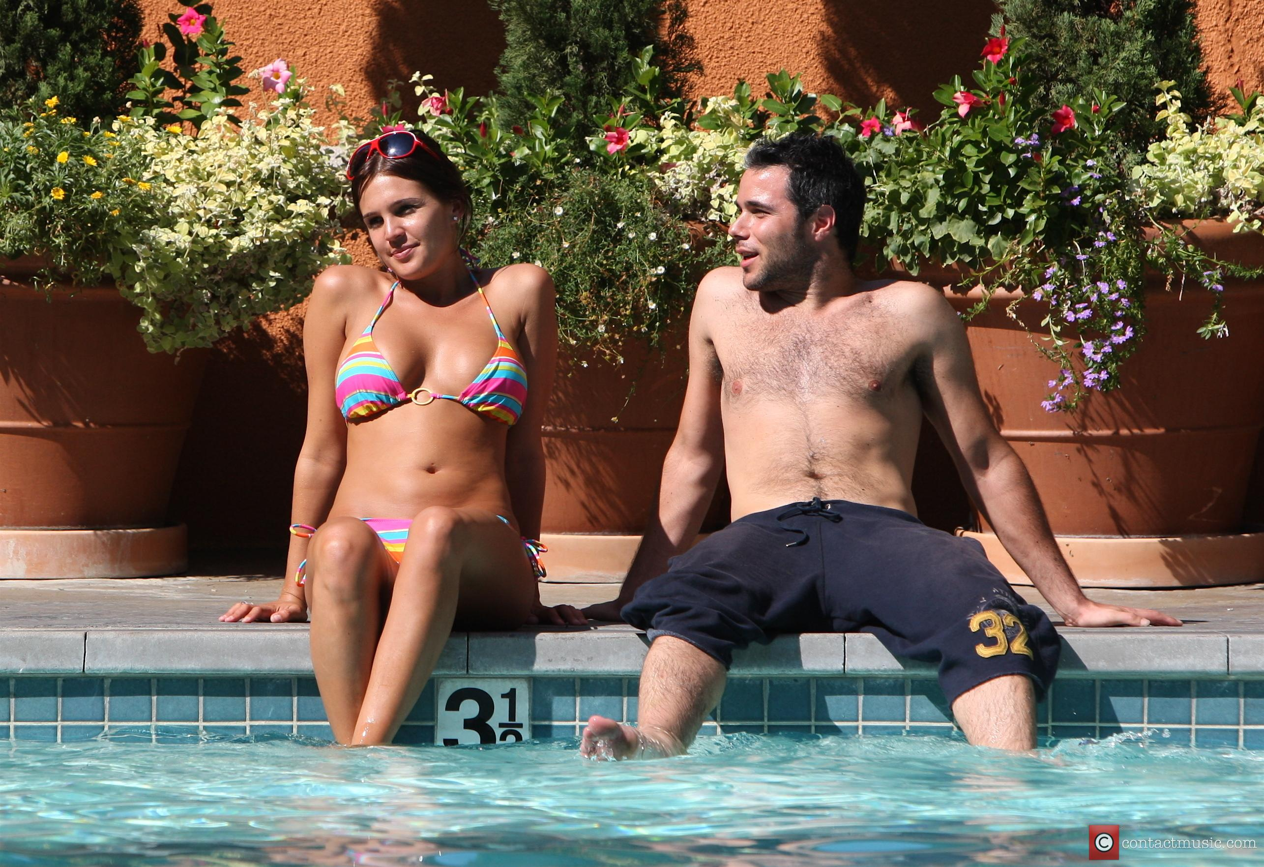 Danielle Lloyd and Her Friend Owen Beiny Sunbath By A Hotel Pool 2