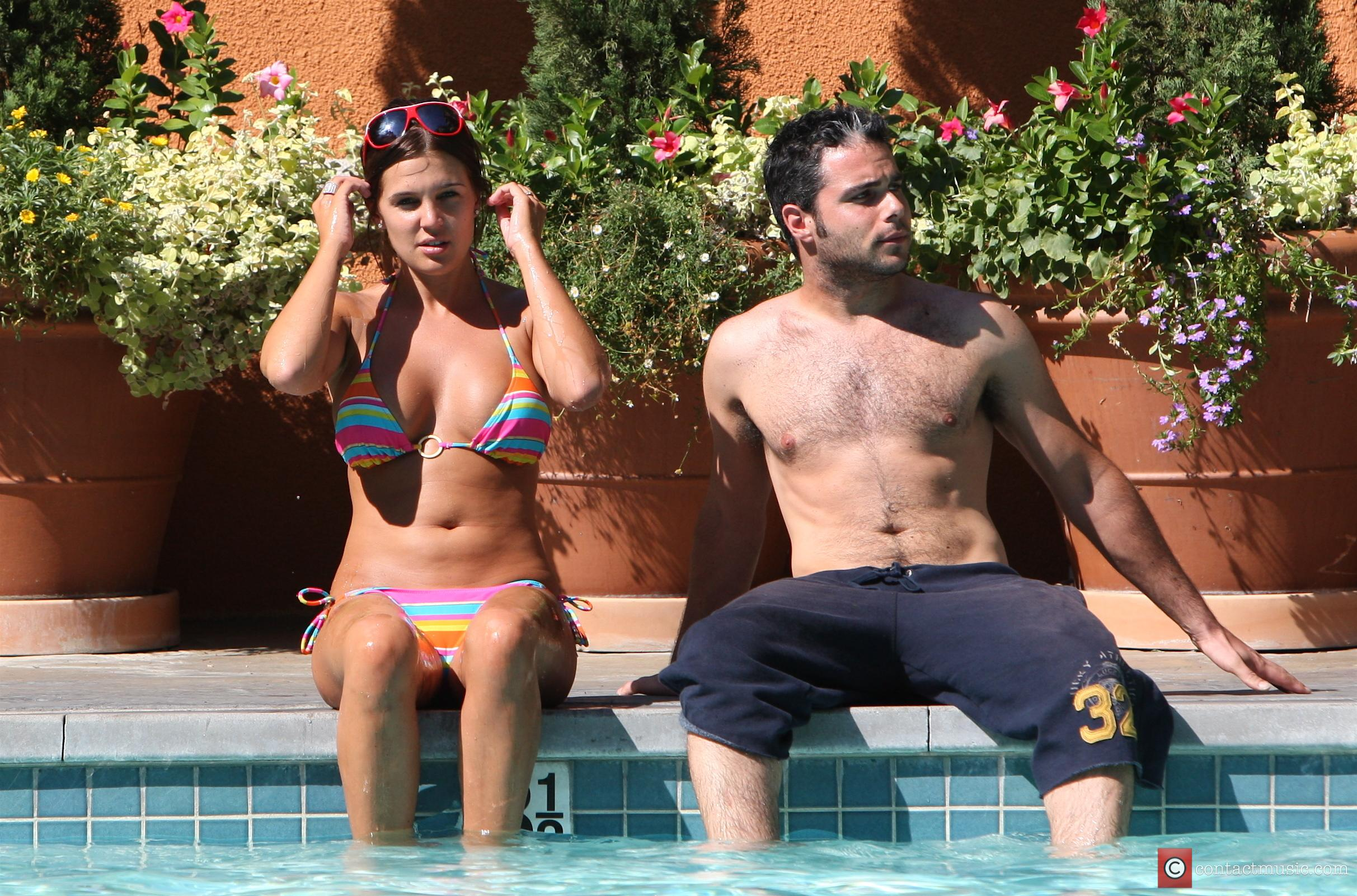 Danielle Lloyd and Her Friend Owen Beiny Sunbath By A Hotel Pool 4