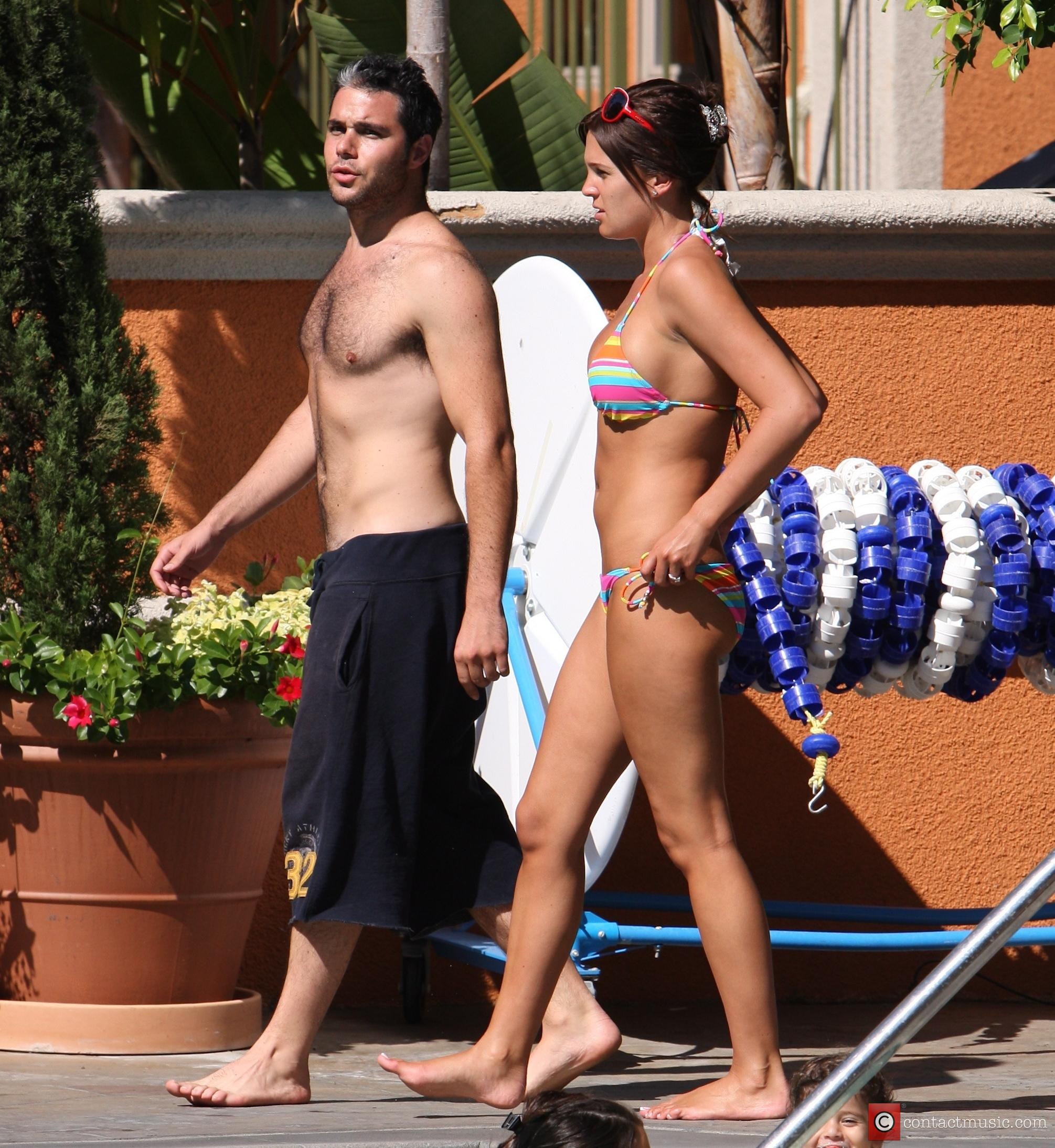 Danielle Lloyd and her friend Owen Beiny sunbath by a hotel pool 7