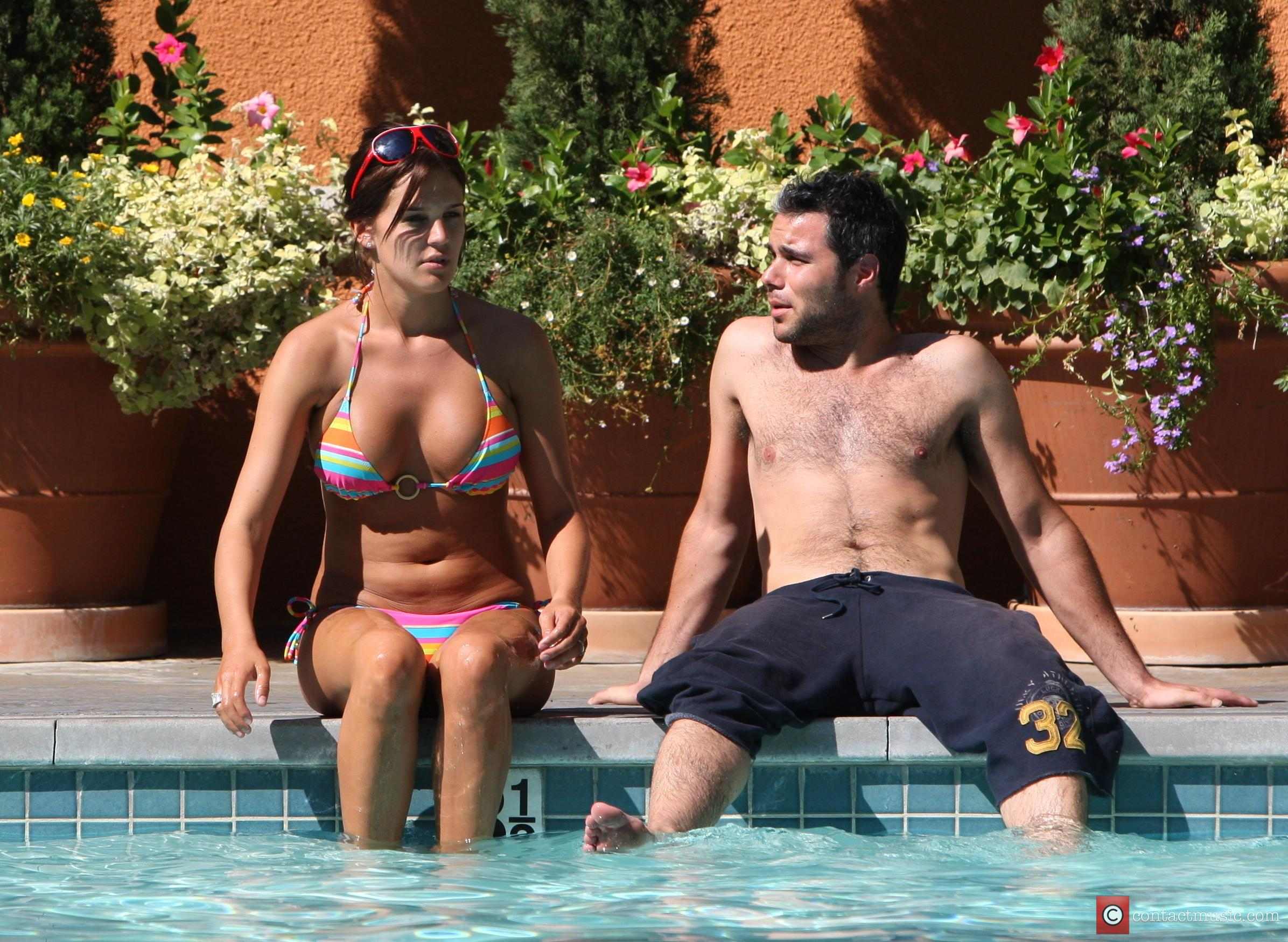 Danielle Lloyd and her friend Owen Beiny sunbath by a hotel pool 8